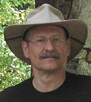Photo of Dr. Tom wearing a hat.